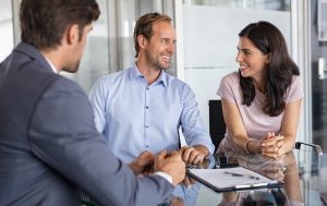 A picture of mature couple meeting financial advisor to illustrate client relationships