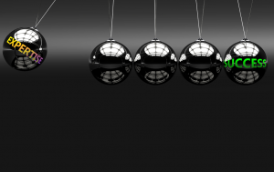 Picture of pendulum balls illustrating expertise is key to success in building trust